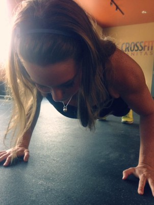 """Miss Strong wearing """"Kettlebell Bling"""" necklace during a workout!"""